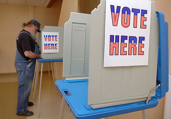 Mark McHendry cast his vote in the county election Tuesday at Calvary Baptist Church. (Staff Photo by BILLY HEFTON)