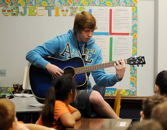 Enid High School junior, Matt Killam, plays his guitar during a Red Ribbon hero presentation at Taft Elementary School Wednesday, Oct. 30, 2013. Killam, and other EHS students discussed how they have chosen to be drug and alcohol free in spite of peer pressure since middle school. (Staff Photo by BONNIE VCULEK)