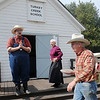 Turkey Creek School marm Dee Taylor (center) smiles as Cody Jolliff (left) thanks Andy Martin (right) and other individuals who purchased pies at the benefit pie auction during Family Farm Day at the Cherokee Strip Regional Heritage Center and Humphrey Heritage Village Saturday, Oct. 26, 2013. Martin, who demonstrated the art of broom making during the event, paid $125 for Taylor's homemade pecan pie. (Staff Photo by BONNIE VCULEK)