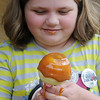 Julie Green enjoys a caramel apple during Family Farm Day at the Cherokee Strip Regional Heritage Center and Humphrey Heritage Village Saturday, Oct. 26, 2013. (Staff Photo by BONNIE VCULEK)