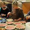 Ladies assemble rhubarb pies for the Mennonite Relief Sale at Grace Mennonite Church, 4006 Oakwood Road, Thursday, Oct. 31, 2013. Volunteers prepared more than 250 pie crusts and fillings for apricot, apple, cherry, peach, pecan, strawberry rhubarb, rhubarb, sour cream raisin and several others. (Staff Photo by BONNIE VCULEK)