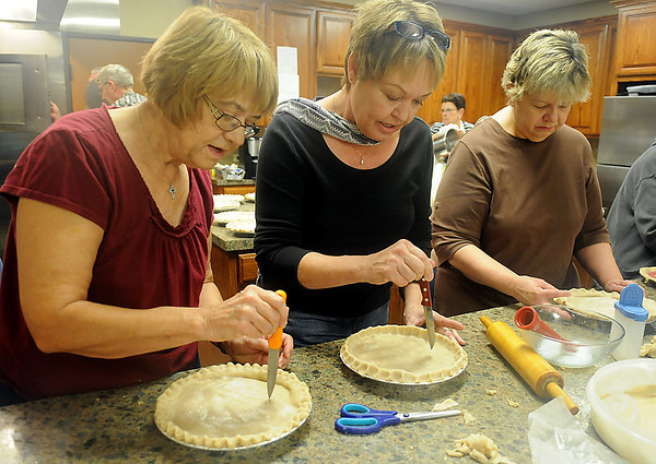 Ladies from Grace Mennonite Church assemble rhubarb pies Thursday, Oct. 31, 2013, for the annual Mennonite Relief Sale at the Chisholm Trail Expo Center Friday-Saturday. Proceeds from the two-day event support disaster relief efforts around the world. (Staff Photo by BONNIE VCULEK)