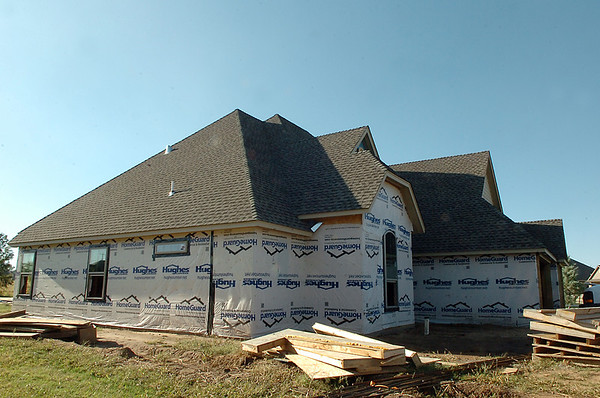 A home being built by Richardson Homes in the Pheasant Run subdivision. The Oklahoma City-based company held their grand opening for its Enid sales office Monday. (Staff Photo by BILLY HEFTON)