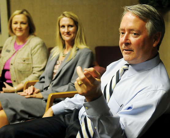 Paula Bowles and Marcie Mack (from left) listen as Dr. Robert Sommers (right), head of the Oklahoma CareerTech Department, answers a question for Jeff Funk during an editorial board meeting at Enid News and Eagle Friday, Oct. 11, 2013. (Staff Photo by BONNIE VCULEK)