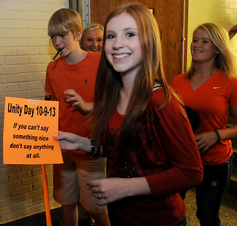 Waller Middle School National Jr. Honor Society and student council members enter the anti-bullying assembly during Unity Day Wednesday, Oct. 9, 2013. Students, faculty and staff wore orange as part of the day's festivities. ATS Counseling-Focus Institute and Waller Middle School sponsored the program. (Staff Photo by BONNIE VCULEK)