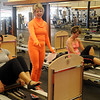 Kelley Wright, portrays GYM for Halloween, as she instructs an advanced pilates class at GYM Thursday, Oct. 31, 2013. (Staff Photo by BONNIE VCULEK)