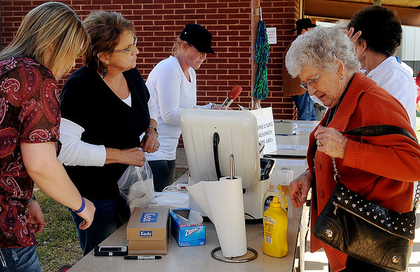 Guests purchase bierocks during Redeemer Lutheran Church's Oktoberfest Saturday, Oct. 5, 2013. (Staff Photo by BONNIE VCULEK)