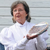 Sandy Clark offers her Southern Georgia pecan pie to the highest bidder during Family Farm Day at the Cherokee Strip Regional Heritage Center's Humphrey Heritage Village Saturday, Oct. 26, 2013. (Staff Photo by BONNIE VCULEK)