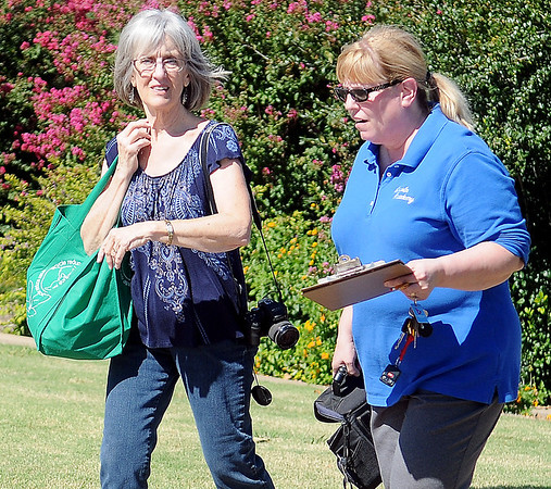 George Ann Ford and Connie Hood leave Dillingham Gardens after tagging several Monarch butterflies during Monarch Watch with Kansas University Tuesday, Oct. 1, 2013. (Staff Photo by BONNIE VCULEK)
