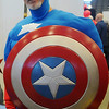 Captain America, portrayed by Ernie Currier, urges guests to try the Security National Bank chili recipe during the 26th annual United Way Chili Cookoff at the Enid Event Center Friday, Oct. 25, 2013. (Staff Photo by BONNIE VCULEK)