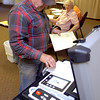 Van Williams feeds his ballots into the voting machine after casting his vote in the county election Tuesday at Zion Lutheran Church in Fairmont. (Staff Photo by BILLY HEFTON)