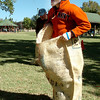Brandon Hoskins takes part in a potato sack race Sunday during the Denny Price Family YMCA's Sundae in the Park at Government Springs Park.(Staff Photo by BILLY HEFTON)