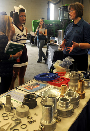 Lisa Steichen (right) visits with Garber High School students about products produced at Parrish Manufacturing Group during Autry Technology Center's Manufacturing Day Friday, Oct. 4, 2013. (Staff Photo by BONNIE VCULEK)