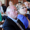 "Enid Regional Development Alliance members and guests listen as Dr. Gerald Clancy, from the OU School of Community Medicine and President of the University of Oklahoma, Tulsa, discusses ""The Affordable Care Act and Beyond; Understanding US Health Care Tectonics at Oakwood Country Club Thursday, Oct. 10, 2013. (Staff Photo by BONNIE VCULEK)"