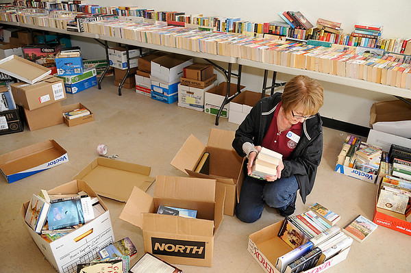 Gerry Brown sorts through boxes of books for the Hospice Circle of Love's 25th annual fall book sale to be held October 18 and 19. (Staff Photo by BILLY HEFTON)
