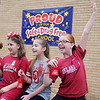 "Mackenzie Smith, Nevaeh Prock and Courtney Sutton (from left) yell, ""I Plant a Promise to be drug free!"" during red ribbon festivities at Taft Elementary School Tuesday, Oct. 29, 2013. Students received miniature red shovels labeled ""Plant a Promise"" before they dug holes for red tulip bulbs around the school, symbolizing their promise to remain drug free. Once the tulips bloom, students will be reminded of their drug free pledge. (Staff Photo by BONNIE VCULEK)"