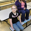 Maeli Powell (front) sits with Macie McCollum in the Chisholm Elementary School cafeteria Tuesday October 15. Powell performed the Heimlich maneuver on her classmate, McCollum, last week when McCollum began choking while eating lunch. (Staff Photo by BILLY HEFTON)