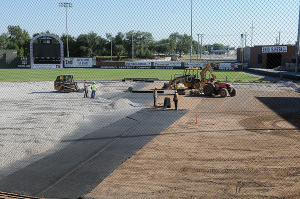 Construction continues on the new artificial turf infield at David Allen Memorial Ballpark Thursday, Oct. 10, 2013. (Staff Photo by BONNIE VCULEK)
