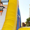 Oliver Kanzelmeyer slides down an inflatable bouncing slide Tuesday during the annual Fall Fest at Vance Air Force Base. (Staff Photo by BILLY HEFTON)