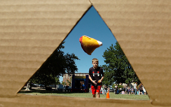 Wilson Player scores a bullseye in the bean bag toss Sunday during the Denny Price Family YMCA's Sundae in the Park at Government Springs Park.(Staff Photo by BILLY HEFTON)