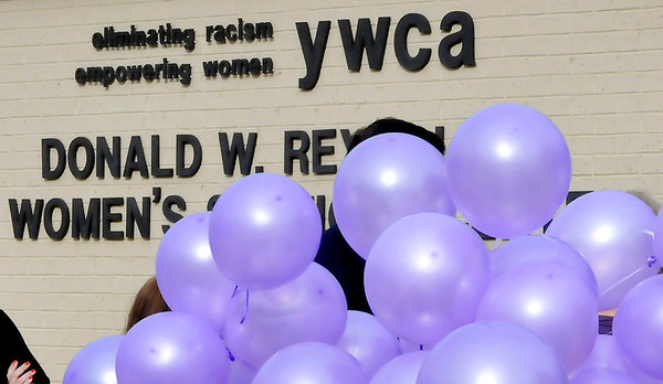 Purple balloons wait to be released in rememberance of female victims of domestic violence during a ceremony at the Enid YWCA Tuesday. (Staff Photo by BILLY HEFTON)