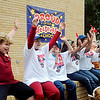 "Taft Elementary School students yell, ""I Plant a Promise to be drug free!"" during red ribbon festivities Tuesday, Oct. 29, 2013. Students received miniature red shovels labeled ""Plant a Promise"" before they dug holes for red tulip bulbs around the school to symbolize their promise to remain drug free. Once the tulips bloom, students will be reminded of their drug free pledge. (Staff Photo by BONNIE VCULEK)"