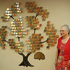 Carolyn Morris stands near St. Mary's Volunteers Tree of Life during a reception honoring Morris's sister, Wanda Cook, Wednesday, Oct. 2, 2013. Cook, a long time volunteer at St. Mary's Regional Medical Center, left a generous donation to the medical center to establish an endowment and for future projects and scholarships awarded through the Volunteer Program at St. Mary's. (Staff Photo by BONNIE VCULEK)