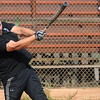 Patrolman Kenyon Hughes blasts a single into center field during the Enid Fraternal Order of Police Lodge 144 benefit softball tournament at Kellet Ballpark Saturday, Oct. 26, 2013. Donations raised will aid Susan Bench, who was diagnosed and treated for breast cancer last summer. (Staff Photo by BONNIE VCULEK)