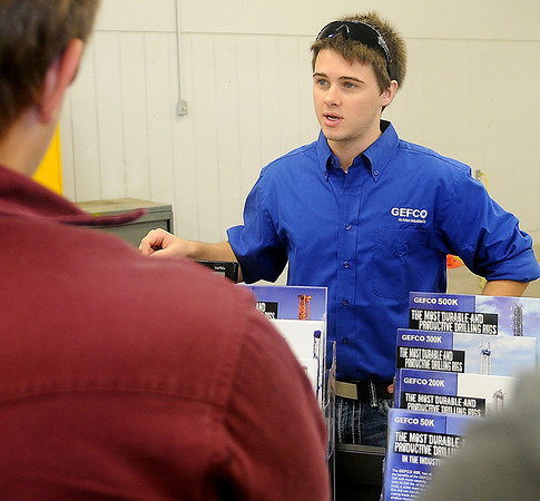 Geoffrey Washburn, from GEFCO, discusses job opportunities during a manufacturing day at Autry Technology Center Friday, Oct. 4, 2013. Washburn, who attended Autry during high school, was hired by GEFCO because of the training he received at the technology center. (Staff Photo by BONNIE VCULEK)