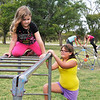 Shayla Kephart, Serita Kephart, Siena Kephart and Chelsea Schulz on the playground equipment at the Carmen City Park Sunday. The town of Carmen has received and anonymous donation to purchase the first new equipment for the park since the 1920's. (Staff Photo by BILLY HEFTON)
