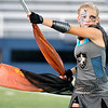A member of the Hennessey High School marching band flag corp during the band's performance in the Tri-State Music Festival marching competition Tuesday at D. Bruce Selby Stadium. (Staff Photo by BILLY HEFTON)