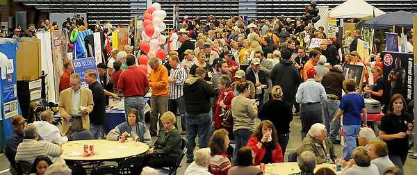 Chili enthusiasts taste 40 different chili recipes during the 26th annual United Way Chili Cookoff at the Enid Event Center Friday, Oct. 25, 2013. The American Red Cross chili was the judge's favorite and the KNID 107.1 MASH booth won Best Decorations. (Staff Photo by BONNIE VCULEK)