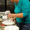 Sandi Gragg makes sour cream raisin pies as Grace Mennonite Church members and volunteers assemble and bake more than 125 pies Thursday, Oct. 31, 2013. The Mennonite Relief Sale, which raises money for disaster relief around the world, begins Friday afternoon and runs thru Saturday at the Chisholm Trail Expo Center. (Staff Photo by BONNIE VCULEK)