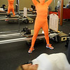 Kelley Wright, portrays GYM for Halloween, as she instructs a pilates class at GYM Thursday, Oct. 31, 2013. (Staff Photo by BONNIE VCULEK)