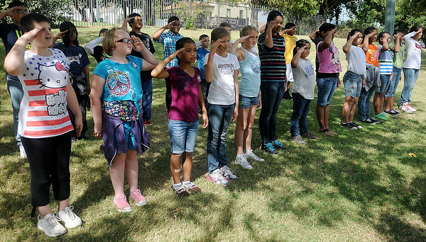 Fifth-grade students in Mrs. Hollee Terry's class at Garfield Elementary School salute their Civil Defense instructors at the end of their youth corp training at the Cherokee Strip Regional Heritage Center Thursday, Oct. 3, 2013. (Staff Photo by BONNIE VCULEK)