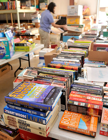 Julie Nelson sorts through boxes of books for the Hospice Circle of Love's 25th annual fall book sale to be held October 18 and 19. (Staff Photo by BILLY HEFTON)