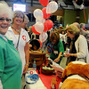 Ward Petroleum employees don scrubs in the Ward Hospital chili booth as they assist their clients with a bowl of chili and all the fixin's during the 26th annual United Way Chili Cookoff at the Enid Event Center Friday, Oct. 25, 2013. (Staff Photo by BONNIE VCULEK)