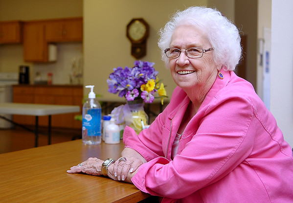 Outgoing coordinator of the Enid Senior Center, Margy Weldon, sits at her desk October 9. After six years as coordinator, she is looking for someone to replace her. (Staff Photo by BILLY  HEFTON)