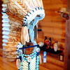 """Dewayne Colwell's wood turned headdress and breast plate, which won the Oklahoma State Fair's """"Best in Show,"""" appears in his home at 7 Wilderness Road in Enid Tuesday, Oct. 14, 2014. Colwell will teach a woodturning class at Autry Technology Center in November. (Staff Photo by BONNIE VCULEK)"""