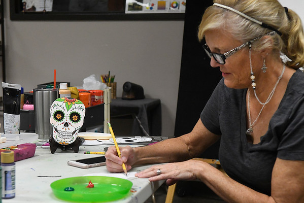 Lori Hill sketches a design for a sugar skull at Creative Arts Enid Tuesday October 25, 2016. (Billy Hefton / Enid News & Eagle)