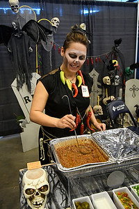 Jacey Petty, from the Smoke Wagon, stirs the chili during the United Way Chili Cook Off Friday October 14, 2016 at the Central National Bank Center. (Billy Hefton / Enid News & Eagle)