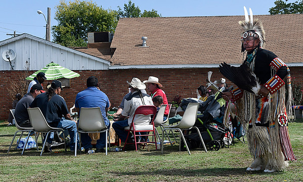 Dennis Begay dances during the 16th Pow Wow at the Leona Mitchell Southern Heights Heritage Center and Museum as members of the Cedar Creek Singers play the drum Saturday October 1, 2016. (Billy Hefton / Enid News & Eagle)
