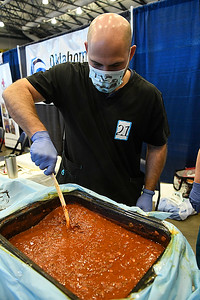 Brandon Gilson, from Youth & Family Services, stirs a pot of chili during the United Way Chili Cook Off Friday October 14, 2016 at the Central National Bank Center. (Billy Hefton / Enid News & Eagle)
