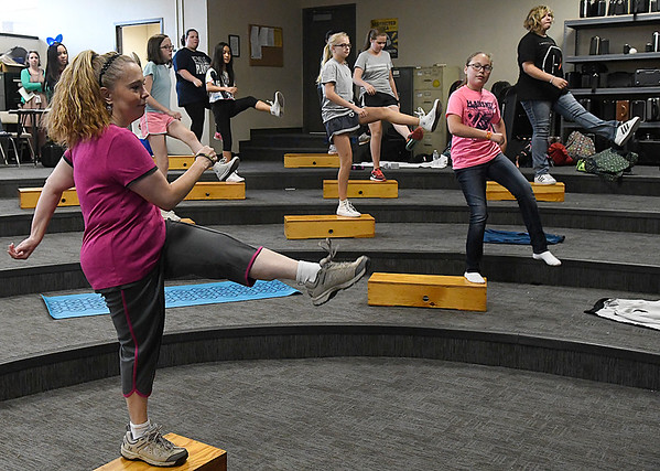 Waller Middle School band director, Lisa Elbora, leads students in step exercise during a meeting of the Waller Fitness Club Tuesday October 25, 2016. (Billy Hefton / Enid News & Eagle)