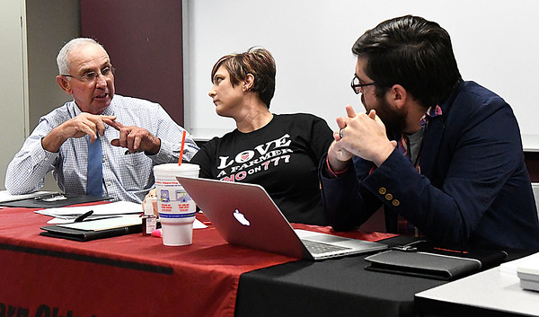 Ben Ezzell (right) and Paulette Rink listen as Bill Steinert (left) makes a point during a forum on SQ 777 Thursday October 27, 2016 at NWOSU Enid. (Billy Hefton / Enid News & Eagle)