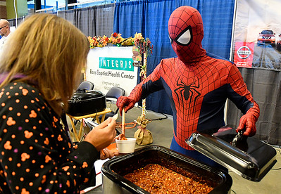 Spiderman, a.k.a. Joe Beserra from Stuart Nissan, serves chili during the United Way Chili Cook Off Friday October 14, 2016 at the Central National Bank Center. (Billy Hefton / Enid News & Eagle)