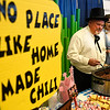 Jeff Abbott and Whitney Bliss, from Messer-Bowers, serve chili during the United Way Chili Cook Off Friday October 14, 2016 at the Central National Bank Center. (Billy Hefton / Enid News & Eagle)