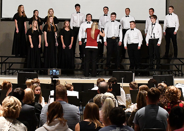 Members of the Oklahoma Bible Academy choir perform during the OBA Fall Concert Tuesday October 18, 2016. (Billy Hefton / Enid News & Eagle)