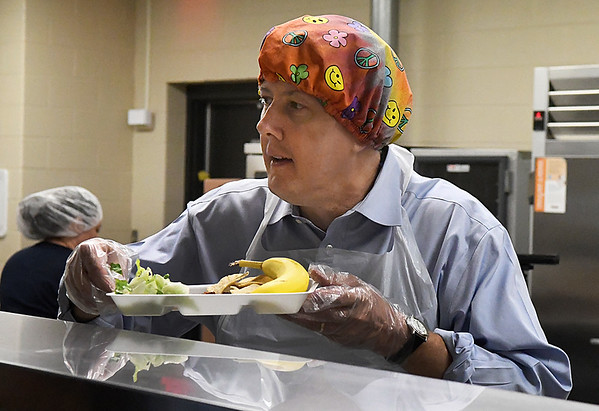 Enid city manager, Jerald Gilbert, helps serve lunch at Garfield Elementary Tuesday October 18, 2016. Gilbert was paying off a wager between the City of Enid and Enid Public School about who could raise the most money for the United Way. (Billy Hefton / Enid News & Eagle)