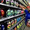 Pedro Chavez straightens a shelf of soccer balls at the Academy store on west Garriott. The store opens today with a grand opening scheduled for next week. (Billy Hefton / Enid News & Eagle)